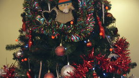 Close up Christmas Tree. Downwards, vertical pan of a fully decorated Christmas tree stock footage