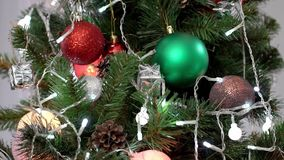 Close up of christmas tree with flashing lights. Close up of decorated christmas tree with flashing lights stock footage