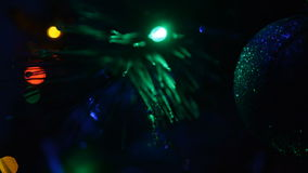 Close up of the Christmas tree with a garland stock footage