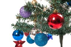 Close up of christmas tree with ornament, bauble, and decoration. Isolated on white background Royalty Free Stock Photography