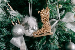 Close up of Christmas tree with ornaments baubles, bow, snowflakes, pine cones and lights. Stock Photos