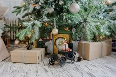Close up christmas tree with presents. And toys, balls, and artificial snow royalty free stock image