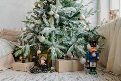 Close up christmas tree with presents. And toys, balls, and artificial snow Stock Photography