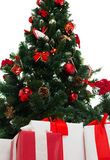 Close up of christmas tree and presents Stock Photos