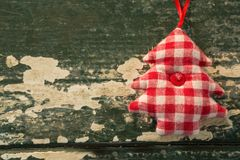 Close up of Christmas tree shape with checked patter. On wooden table Stock Photo