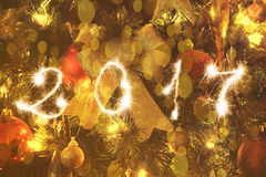 Close up on Christmas tree and sparkling 2017 sign Stock Photography