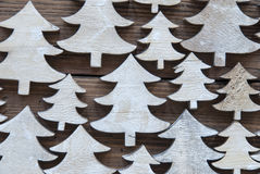 Close Up Of Christmas Trees On Wooden Background Royalty Free Stock Photo