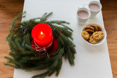 Close up of christmas wreath with candle on table Royalty Free Stock Photography