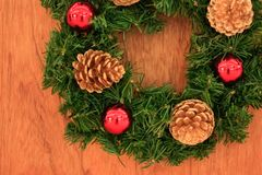 Close up christmas wreath on wooden background, soft focus.  Stock Photos