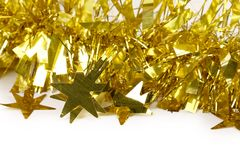 Close up of christmas yellow tinsel. Royalty Free Stock Images