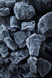 Close up of chunks black coal on which the rime Stock Photo