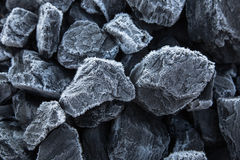 Close up of chunks black coal on which the rime Royalty Free Stock Photo