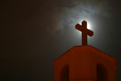 Close-up of a church cross. Church cross silhouetted by the moon Stock Images