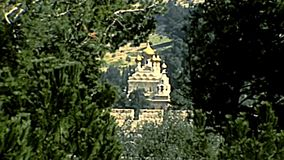 Mary Magdalene Church Jerusalem. Close up of the Church of Mary Magdalene of Russian Orthodox Church in ancient Jewish cemetery. View from Olives Mount. Old stock video footage
