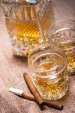 Close up of cigar and whiskey glasses Royalty Free Stock Photos