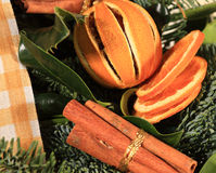 Close up of a cinnamon and oranges wreath royalty free stock image