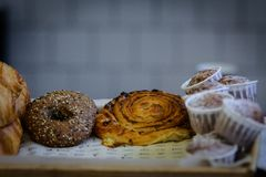Close-up of cinnamon and raisin curl buns, fresh muffins sprinkl royalty free stock photography