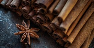 Cinnamon sticks and a star Anise on a dark background. Close up of cinnamon sticks and star anise , background , cooking Stock Photography