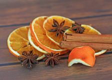 Close up of cinnamon sticks and star anise, slices orange Stock Photos