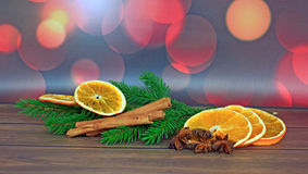 Close up of cinnamon sticks and star anise, slices orange Stock Photography
