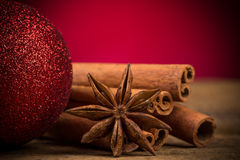 Close up of cinnamon sticks and star anise on wood Royalty Free Stock Photos
