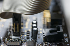 Circuit board and cable. Close-up of circuit board components Stock Photo