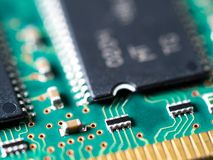 Close-up of circuit board with integrated circuits, resistors and capacitors.  stock image