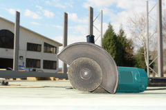 Close-up circular abrasive cutoff saw. Grinding machine on the workplace floor royalty free stock photo
