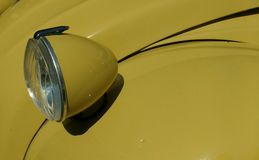 Headlight of an Old Citroën Car. Close-up of a Citroen headlight Stock Image