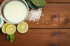 Close up of citrus body lotion in bowl on wood Stock Photo