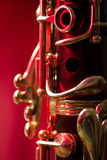 Close-up of a clarinet against a red background Stock Photo