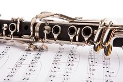 Close-up of clarinet and musical notes Stock Images