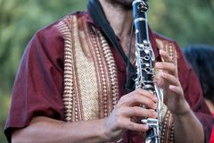 Close up of clarinet player playing at a Klezmer concert of Jewish fusion music in Regent`s Park in London royalty free stock photography