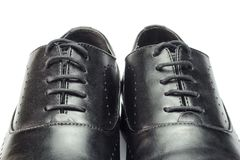 Close-up of classic black leather men`s shoes isolated on white background. Royalty Free Stock Image
