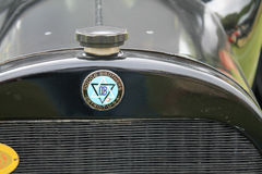 Close up classic car's radiator cap. Classic car's frontend. top of radiator frame and water filler cap ahead of split style hood. black 1918 Dodge Touring Stock Photos