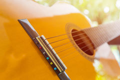 Close up of Classic guitar. Close up detail Classic guitar with tree background Stock Photography