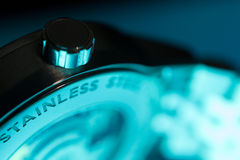 Close Up of Classic Swiss Watch with Aqua Glow Royalty Free Stock Photos