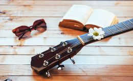 Close up classical guitar head with glasses and book Stock Image