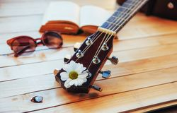 Close up classical guitar head with glasses and book Stock Photo