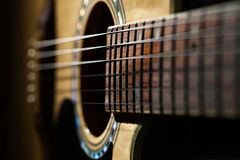 Close-up of classical guitar strings. royalty free stock images