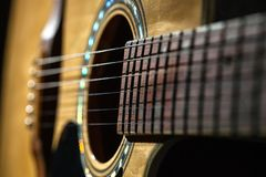 Close-up of classical guitar strings. stock images