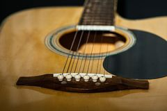 Close-up of classical guitar strings. royalty free stock image
