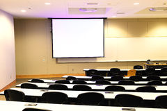 Close up on classroom, seat, table and projector screen Stock Image