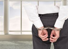 Close up on classy businessman wearing handcuffs Stock Images