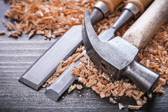 Close up of claw hammer and metal firmer chisels Royalty Free Stock Images