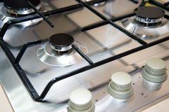 Close-up clean new kitchen gas stove cooker knob heat volume switch elegant metal steel black and white. stock images