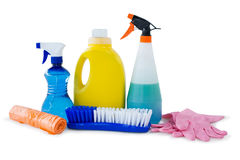 Close up of cleaning liquid with brush and gloves Stock Image