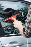 Close-up of cleaning the window royalty free stock photos