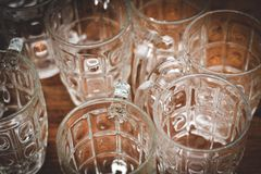 Clear glass for putting water on the restaurant`s wooden table stock images