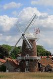 Close up of Cley Windmill. Cley windmill is a five storey tower mill with a stage at second floor level, twenty feet above ground. It has a dome shaped cap with Stock Photography